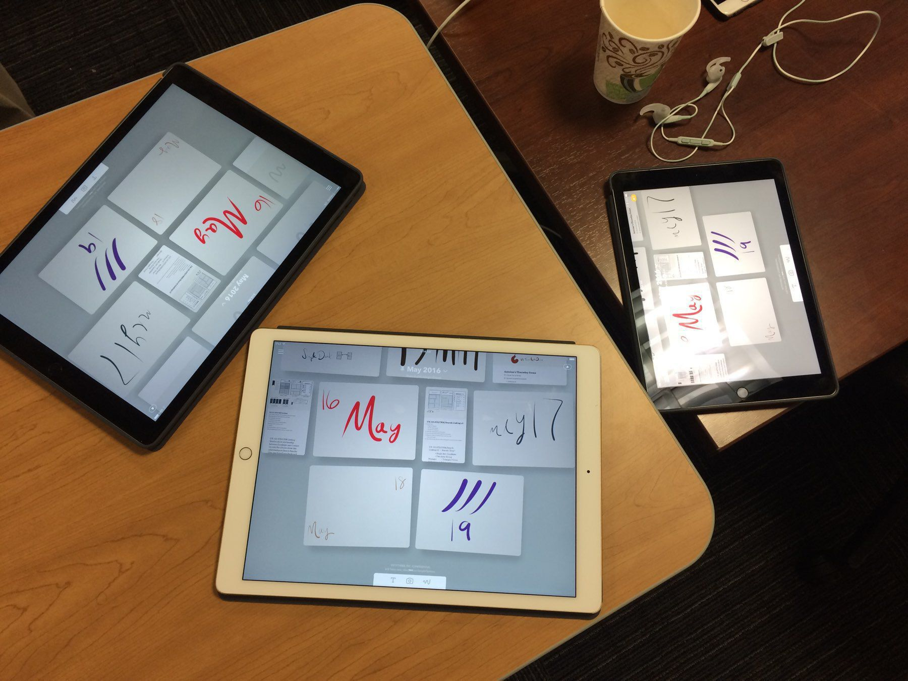 3 iPad devices in an experience design review session