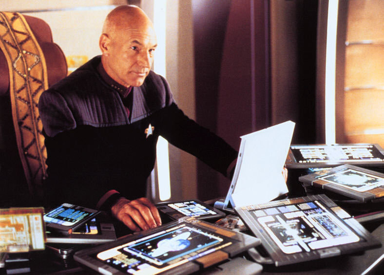 Captain Picard and desk full of tablet computers called PADDson Star Trek TNG